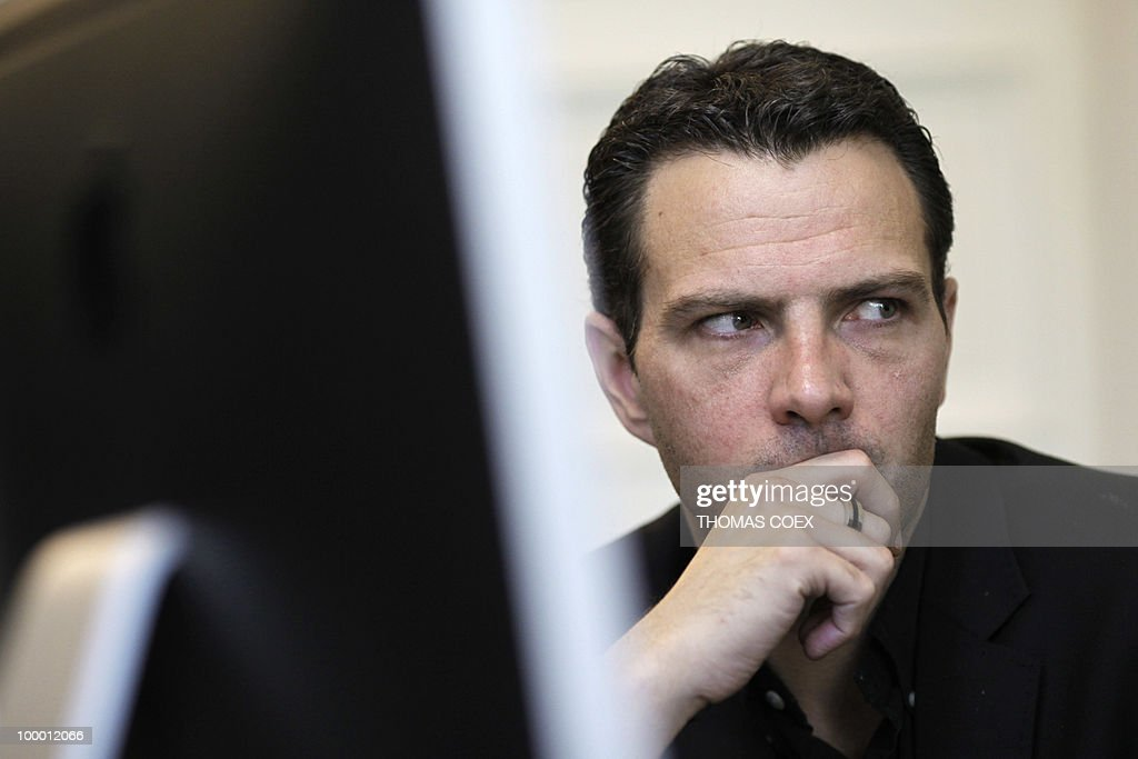 French former trader at Societe Generale bank, Jerome Kerviel gestures on May 20, 2010 while talking with his lawyer at his office in Paris. Kerviel, who will appear in court in Paris from June 8 to 25, 2010, faces a maximum sentence of five years in prison and a fine of 375,000 euros if convicted on charges of breach of trust, falsifying and using fake documents and tampering with computer information.
