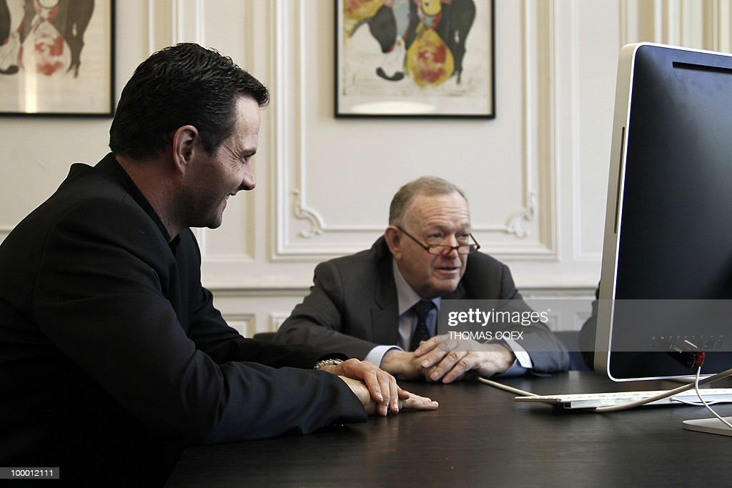 French former trader at Societe Generale bank, Jerome Kerviel works with his lawyer Olivier Metzner (R) on May 20, 2010 at Metzner's office in Paris. Kerviel, who will appear in court in Paris from June 8 to 25, 2010, faces a maximum sentence of five years in prison and a fine of 375,000 euros if convicted on charges of breach of trust, falsifying and using fake documents and tampering with computer information.