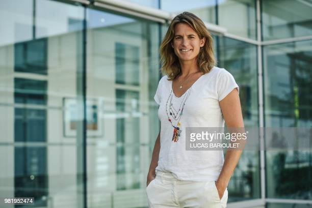 French former world number one Amelie Mauresmo poses following a press conference after she became the first woman appointed to captain France's...