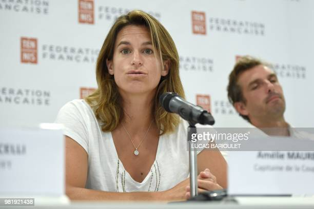 French former world number one Amelie Mauresmo speaks during a press conference after she became the first woman appointed to captain France's Davis...
