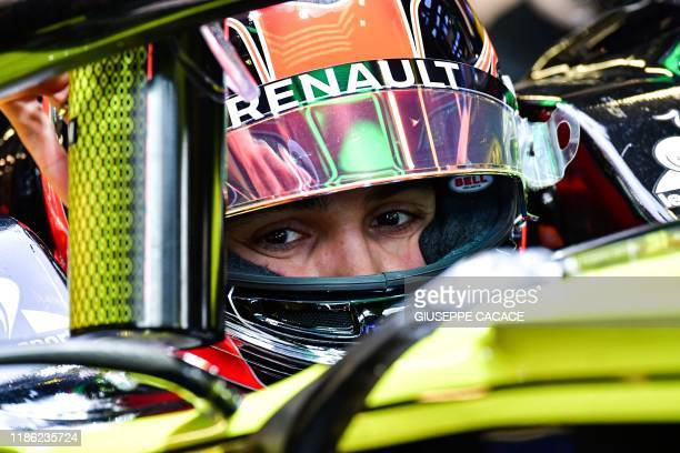 French Formula One driver Esteban Ocon sits in his car during a test day at the Yas Marina Circuit in Abu Dhabi, on December 3, 2019. - The...