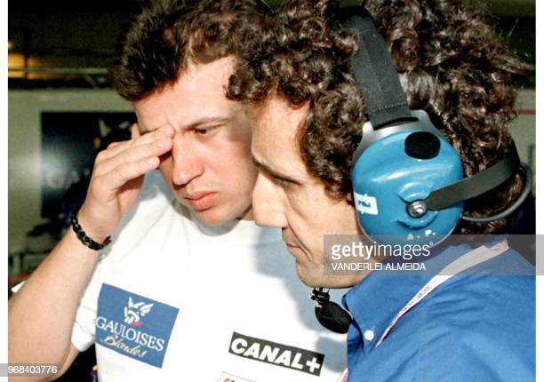 French Formula One driver Olivier Panis talks with Prost team manager Alain Prost during a stop in the pits of the Interlagos race track 28 March in...