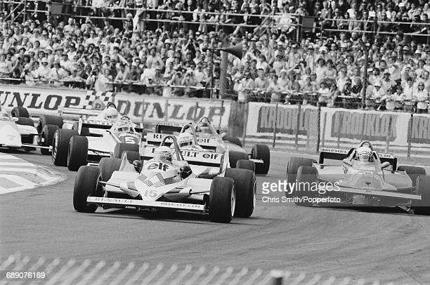French Formula One racing driver Alain Prost drives the Equipe Renault Elf RE30 Renault V6 during the 1981 British Grand Prix at the Silverstone...