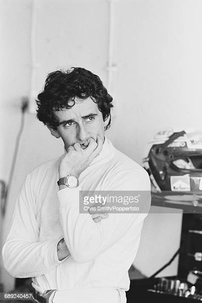 French Formula One racing driver Alain Prost pictured looking pensive and thoughtful during qualifying for the 1984 Portuguese Grand Prix at Estoril...
