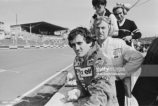 French Formula One racing driver Alain Prost pictured with Renault team manager Gerard Larrousse , timekeeper Michele Dubosc and Renault sporting...