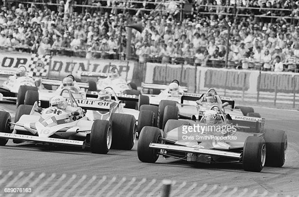 French Formula One racing driver Didier Pironi pictured on right driving the Scuderia Ferrari 126CK Ferrari V6T turbo alongside fellow French racing...