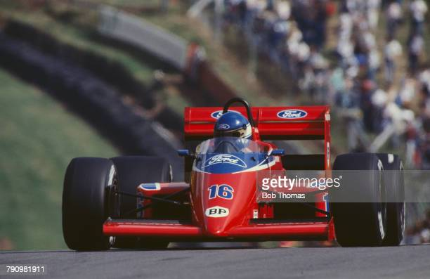 French Formula One racing driver Patrick Tambay drives the Team Haas Lola THL2 Ford Cosworth GBA 1.5 V6t in the 1986 British Grand Prix at Brands...