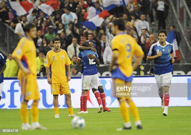 French forward and captain Thierry Henry is congratulated by French defender William Gallas after scoring during the World Cup 2010 qualifying...