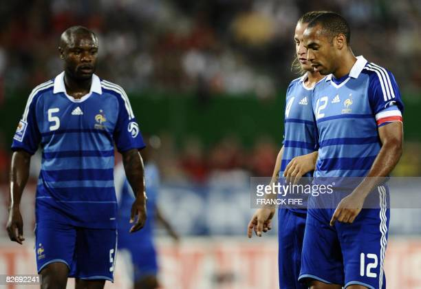 French forward and captain Thierry Henry Philippe Mexes and defender William Gallas reacts during the WC 2010 qualifying football match France vs...