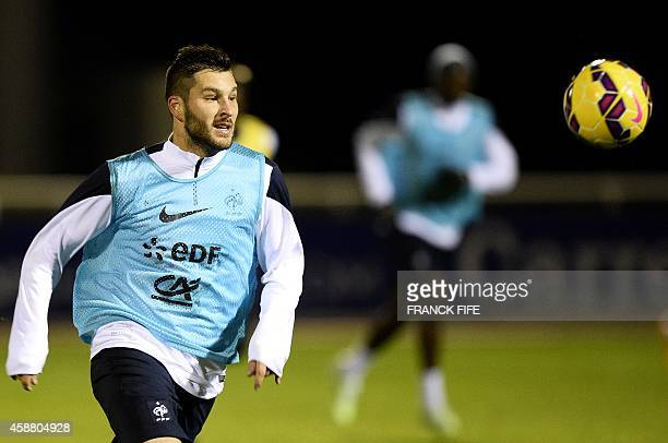 French forward Andre Pierre Gignac eyes the ball during a training session on November 11 as they ready for their friendly football match against...