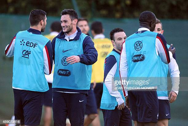 French forward AndrePierre Gignac talks with French goalkeeper and captain Hugo Lloris during a training session two days before the team's friendly...