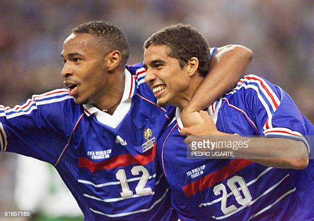 French forward David Trezeguet is greeted by Thierry Henry after he scored the 2nd goal,18 June at the Stade de France in Saint-Denis, during the...