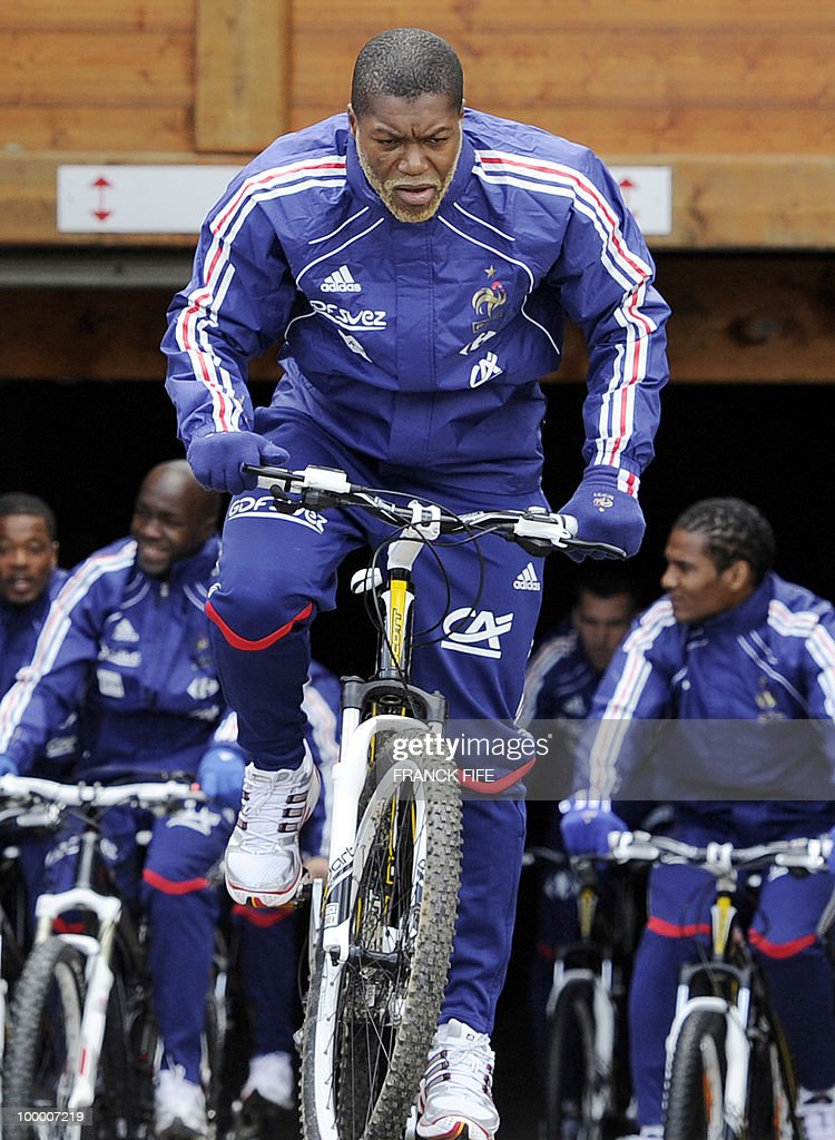 French forward Djibril Cisse (front) leaves the hotel with teammates for a cycling training session around a lake, on May 19, 2010 in Tignes in the French Alps, as part of the preparation for the upcoming World Cup 2010. France will play Uruguay in Capetown in its group A opener match on June 11.