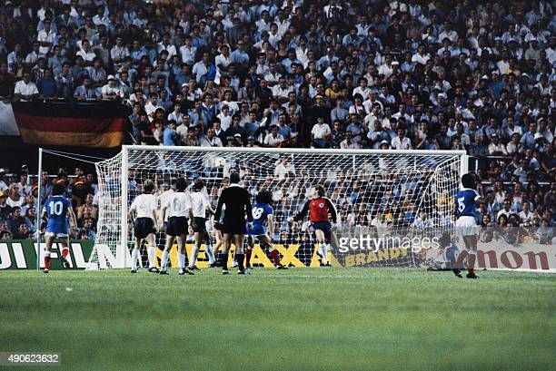 French forward Dominique Rocheteau scores a goal during the 1982 World Cup semifinal football match between West Germany and France on July 8 1982 in...
