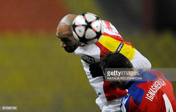 French forward Frederic Kanoute of Sevilla fights for the ball with Sergei Ignashevich of CSKA in Moscow on February 24 2010 during their last 16...
