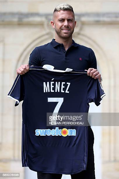 French forward Jeremy Menez poses with his jersey during his introduction as a new player of the French Ligue 1 team Girondins de Bordeaux on August...