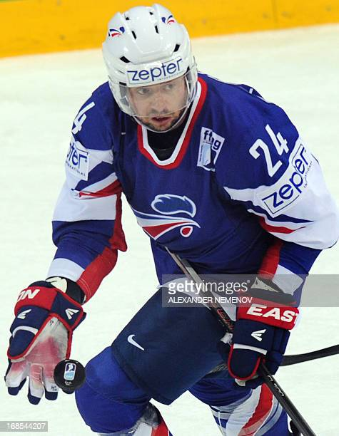 French forward Julien Desrosiers plays the puck during a preliminary round game USA vs France of the IIHF International Ice Hockey World Championship...