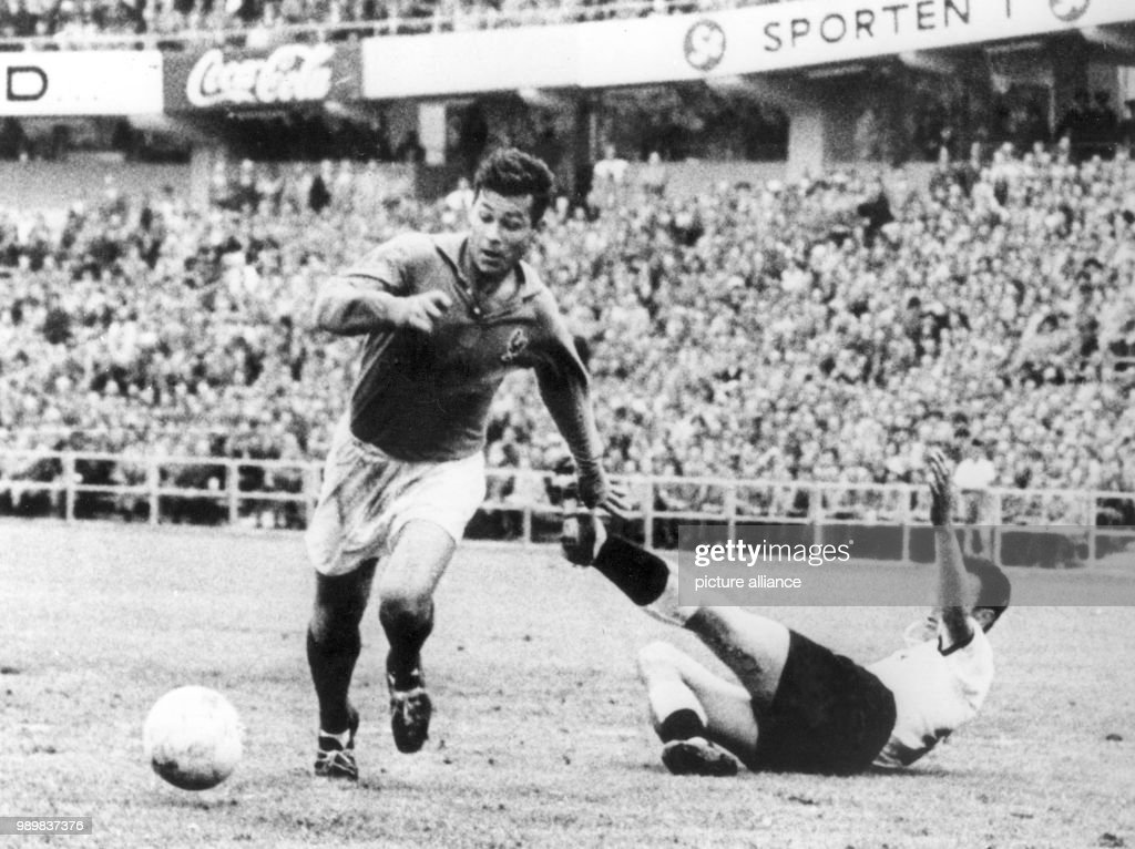 French forward Just Fontaine dribbles past falling German player ...