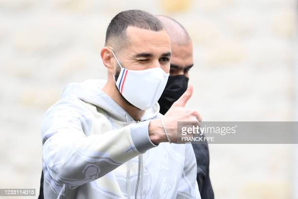 French forward Karim Benzema arrives at the French national football team training base in Clairefontaine en Yvelines on May 26 as part of the team's...