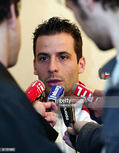 French forward Ludovic Giuly answers journalists' questions 16 November 2004 during a press conference in Clairefontaine, outside Paris on the eve...