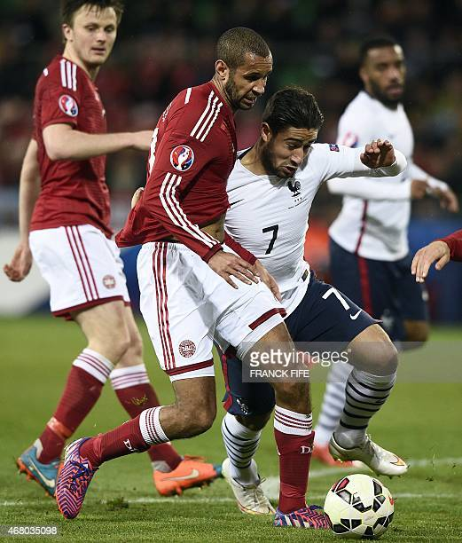 French forward Nabil Fekir vies with Denmark's Simon Busk Poulsen during the friendly football match between France and Denmark on March 29, 2015 at...