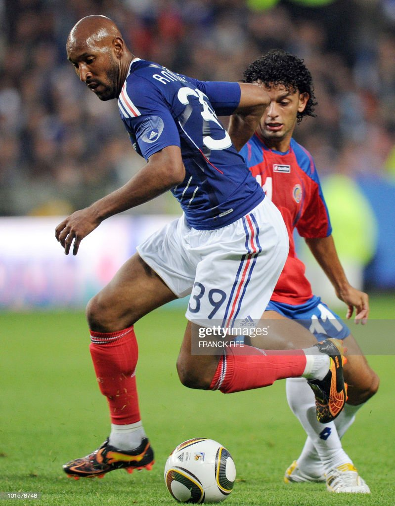 French forward Nicolas Anelka (L) vies with Costa-Rica's Michael Barrantes during the friendly football match France vs. Costa-Rica at the Bollaert Stadium in Lens on May 26, 2010, ahead of the upcoming WC2010 in South Africa.