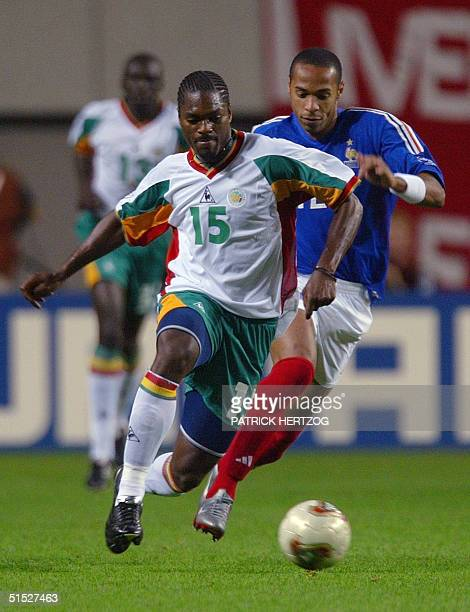 French forward Thierry Henry challenges Senegalese midfielder Salif Diao during the opening match of the 2002 FIFA World Cup Korea/Japan in Seoul 31...