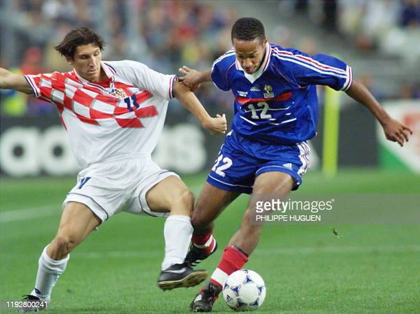French forward Thierry Henry duels with Croatian midfielder Silvio Maric, 08 July during the 1998 Soccer World Cup semifinal match between France and...