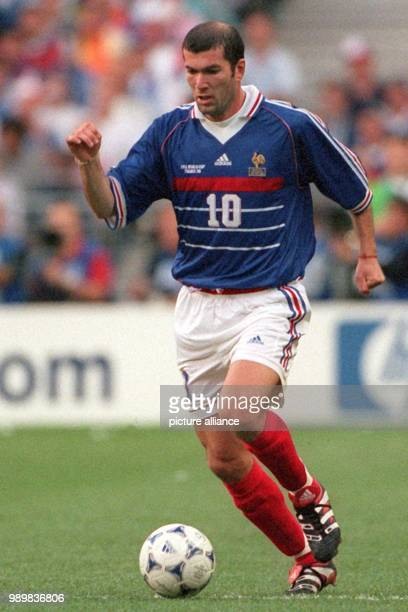 French forward Zinedine Zidane controls the ball during the 1998 World Cup final France against titleholder Brazil at the Stade de France in Saint...
