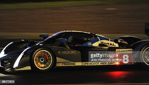 French Franck Montagny drives his Peugeot 908 HdiFAP N°8 during the 77th edition of the Le Mans 24hour endurance race on June 13 western France AFP...