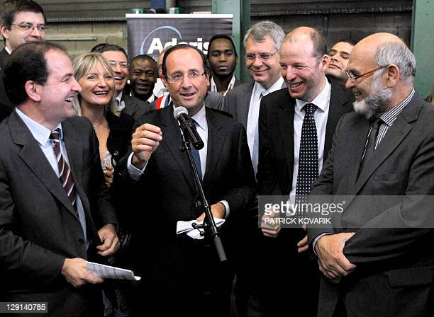 French Francois Hollande candidate of the Socialist party's 2011 primary vote for France's 2012 delivers a speech as he visits the Jacret...