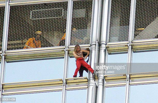 French free climber Alain Robert climbs the 283 metres / 62 storey Cheung Kong Centre in the heart of Hong Kong's Central district 11 June 2005...