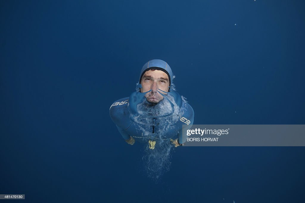 French free diver Guillaume Nery practices apnea during a training session in the Mediterranean sea near Nice on July 18, 2015, ahead of the 2015 AIDA (Association for Development of Apnea) Individ...