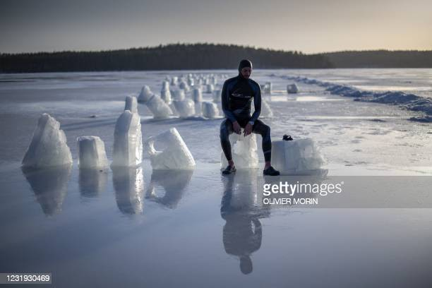 French freediver Arthur Guerin-Boeri, 36-years-old, poses for a photograph after setting a new CMAS World record for Freediving under ice, by...