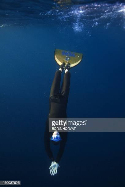 French freediver Morgan Bourc'his trains on August 8 2012 off the coasts of Marseille southern France as part of his preparation fo the world...