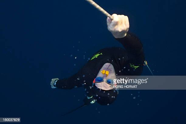 French freediver Morgan Bourc'his trains on August 8 2012 off the coasts of Marseille southern France as part of his preparation for the world...