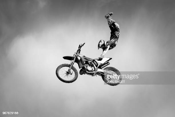 French freestyle motocross rider and world champion Tom Pages practices during a training session in Barcelona on May 26 2018 / BLACK AND WHITE...