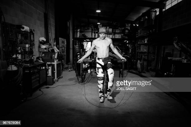 French freestyle motocross rider and world champion Tom Pages warms up prior to a training session in Barcelona on May 26 2018 / BLACK AND WHITE...