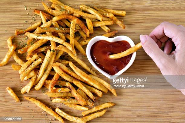 french fries and ketchup - fries imagens e fotografias de stock