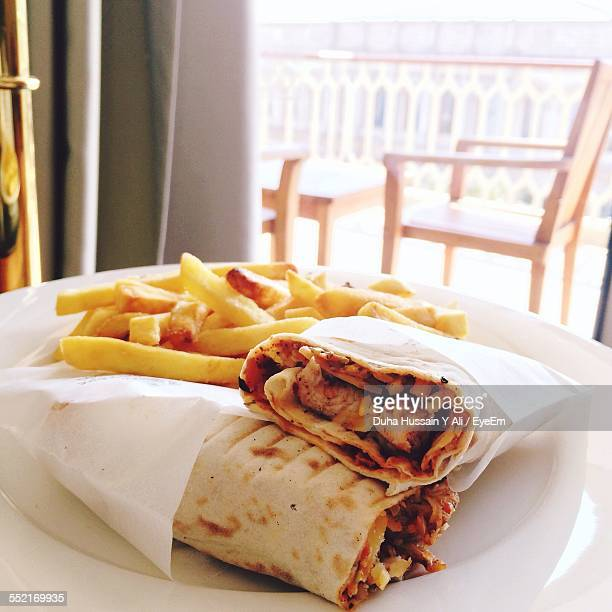 French Fries And Two Kebabs On Plate
