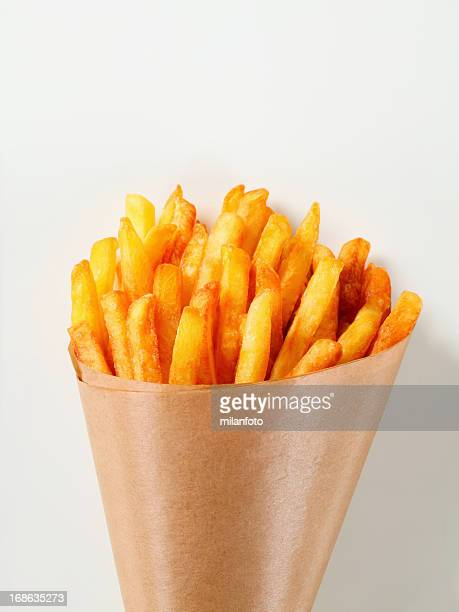 french fries in a paper cone - cone shaped objects stock pictures, royalty-free photos & images
