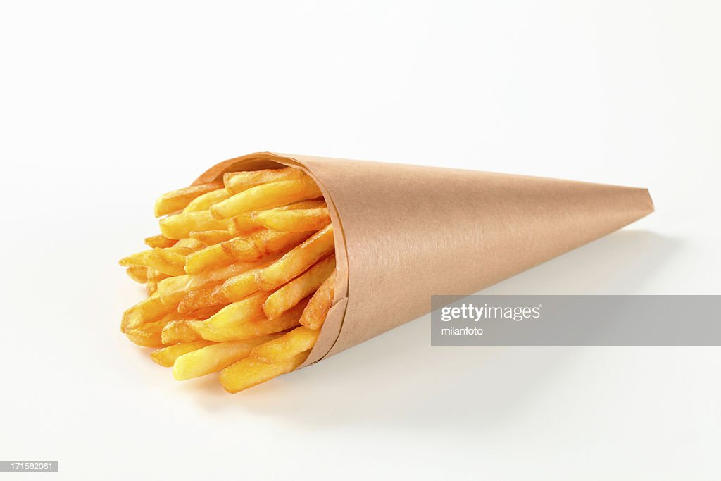 French fries in a paper cone : Stock Photo