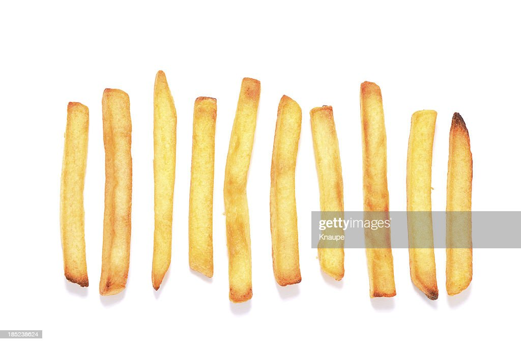 French fries in a row on white background : Stock Photo
