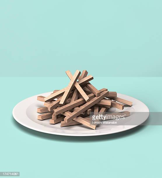 French fries made out of wooden block