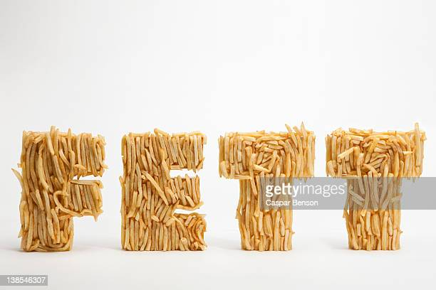 French fries molded to make the word FETT, the German word for fat