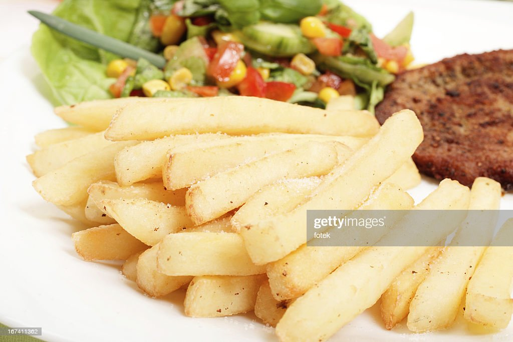 French fries, salad and chop : Bildbanksbilder