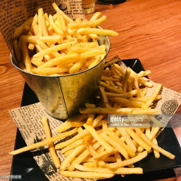 French Fries Served On Table