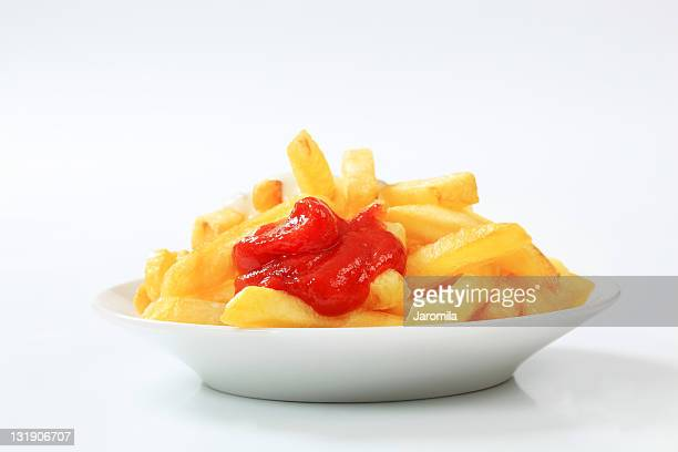 french fries with ketchup - sauce stock pictures, royalty-free photos & images