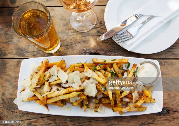 french fries with parmigiano reggiano, herbs and sauce aioli - sauce stock pictures, royalty-free photos & images