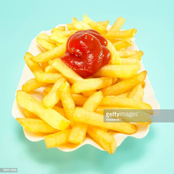 French fries with tomato ketchup, close-up